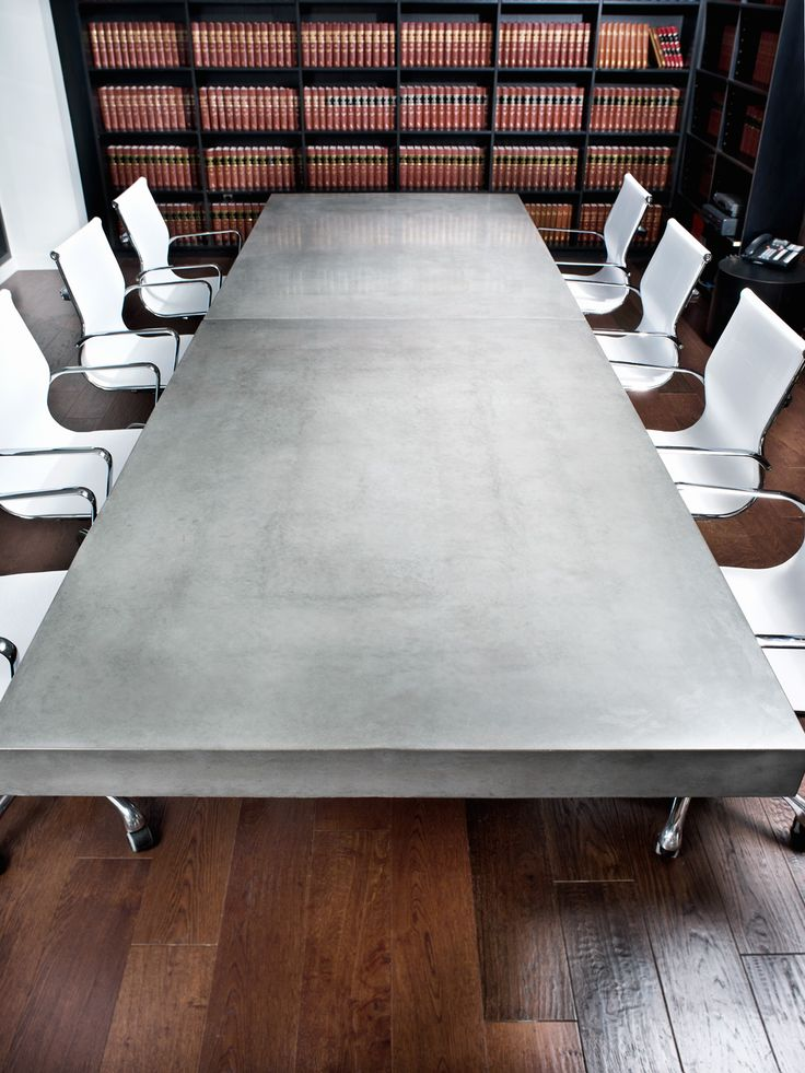 A custom made, concrete table. Concrete displays can add a modern and industrial look to commercial retail settings, institutions, and events. #concrete #table #interior #design #modern #tabletop