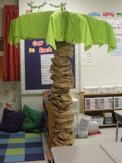 Palm tree in the reading center- use old umbrella frame with round table cloth...?