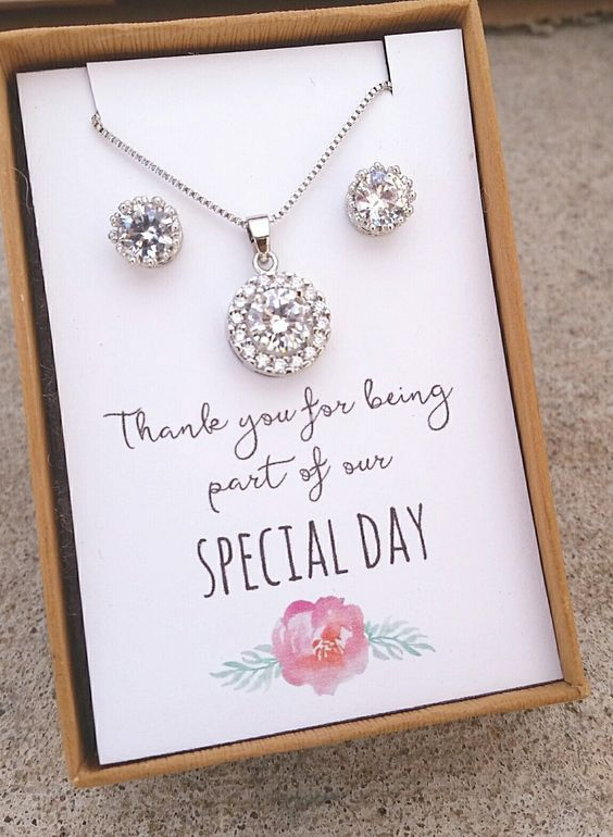 Stunning cubic zirconia necklace and earrings. 17-19 inch chain. Cards will come neatly placed in a beautiful gift box with ribbon. Orders of $150 or more will receive free gift bags shipped seperatel