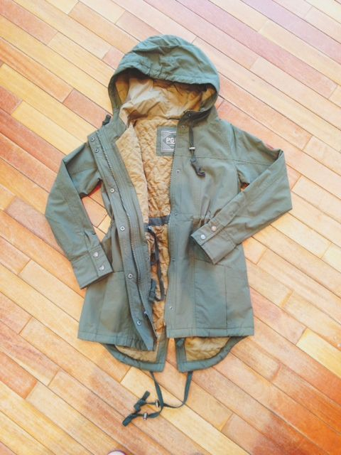 Some kind of Green military rain jacket like this one, this ones just really expensive. They have them at forever 21 and other places