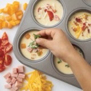 Muffin Omelets :  whip eggs W/1tsp milk per egg. Add cheese ham and veggies (onions, peppers) optional. Mix and pour in greased muffin pan. Bake @350*for 20-25mins