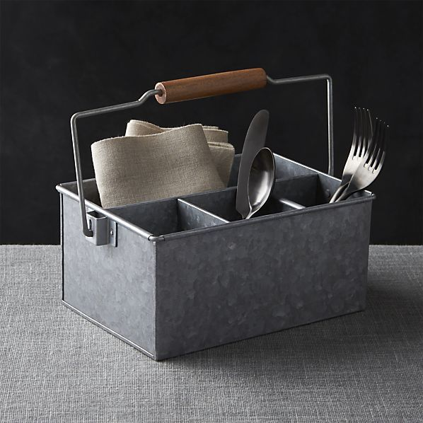 Divided galvanized iron caddy with convenient wood tote handle brings the flatware, condiments and napkins to the table with a certain measure of utilitarian chic.