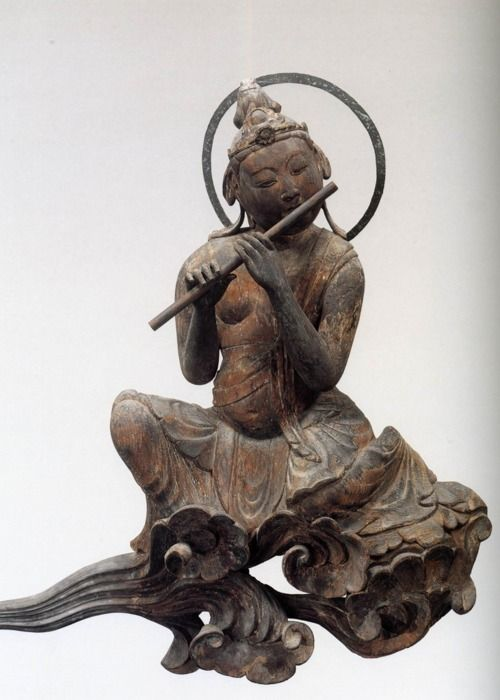 Bodhisattva - Blowing flute. ca 1053. Byodoin Temple - Kyoto, Japan.