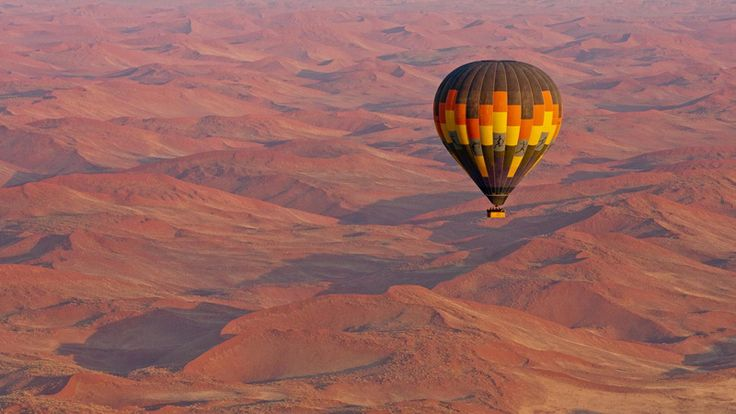 See the Namib desert from the sky in a hot-air balloon on our 10 Day Luxury Namibia Safari #luxurytravel #namibia #sossusvlei