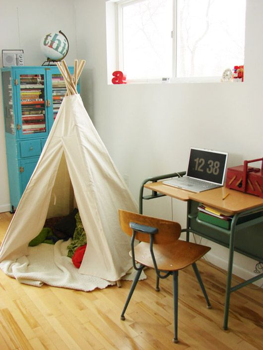 tepee is a must!  love all the colors in this room and the unique vintage desk and chair.