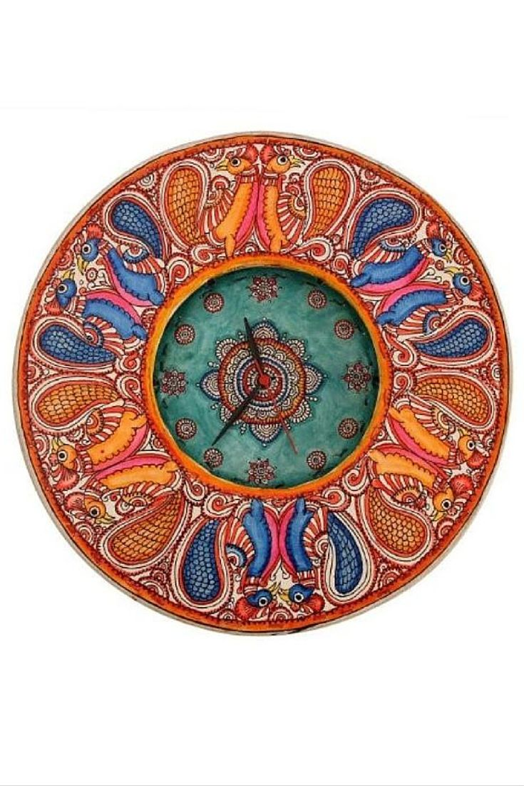 Leather Puppetry Handpainted multicoloured Clock is a classy wall clock. This handpainted clock has been made with a White and multicolors used to enhance the beauty. Leather Puppetry from AP represents the Indian Handicrafts and the amazing artisans work. You can clean this watch easily with wet cloth and the colors will remain as it is. This can be an exclusive gift for your friends and colleagues at work.