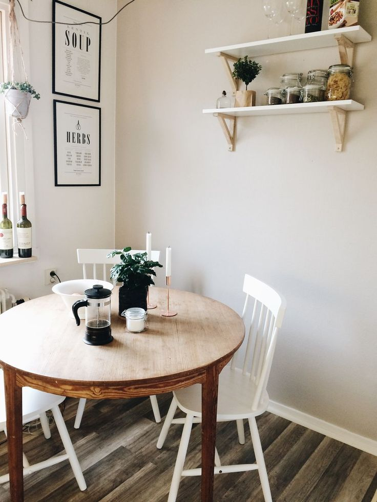 small dining room corner with wooden table and hanging shelves