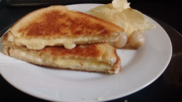 Mature English Cheddar and a Dairylea Slice in White Farmhouse Bread. #grilledcheese #food #yum #foodporn #cheese #sandwich #recipe #lunch #foodie