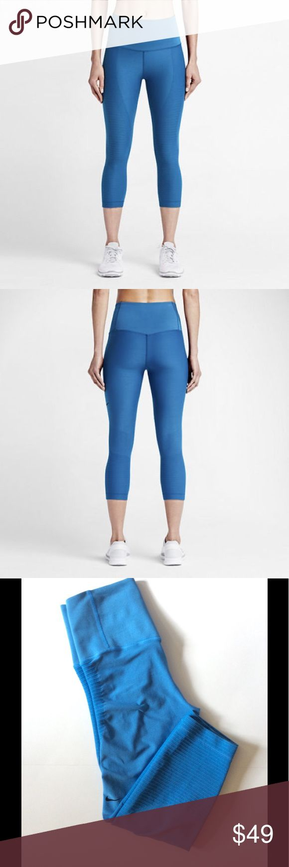 "Nike Zoned Sculpt Tight Fit Training Capri Nike Zoned Sculpt tight fit training capris, blue.  Size large; 13"" width, 10.5"" rise, 21"" inseam.  88% nylon, 12% spandex.  Tights in good used condition.  Last picture shows small thread pulls, there are a few. Nike Pants Track Pants & Joggers"