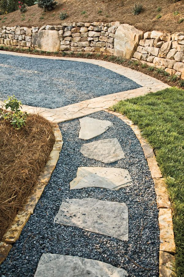 Outdoor Walkway - Hemlock Springs Idea House Tour - Southernliving. Design a Unique Path  Mix stone, gravel, and loose pavers to create interesting patterns and texture on outdoor walkways.