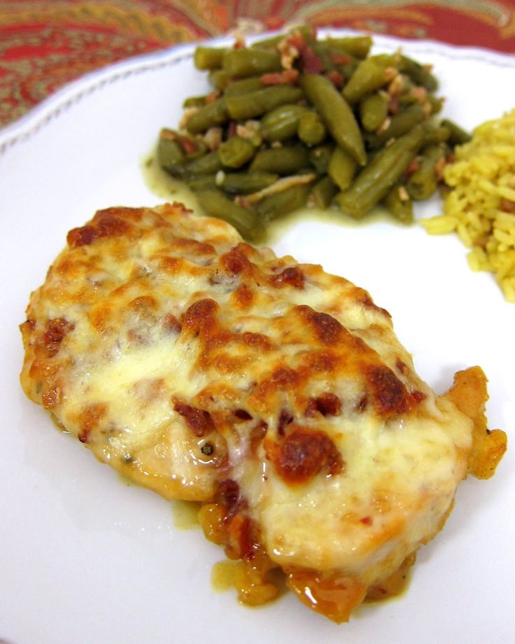 Cheesy Honey Mustard Chicken - TO DIE FOR!!! Chicken topped with honey, mustard, lemon juice, paprika, lemon pepper, bacon, Mozzarella and baked. Ready in under 30 minutes. We ate this two nights in a row. It is that good. Even picky eater love this!