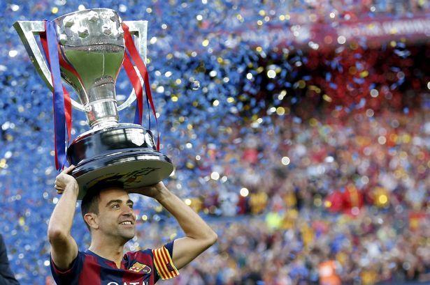 Barcelona's Xavi Hernandez raises the La Liga trophy at Camp Nou!