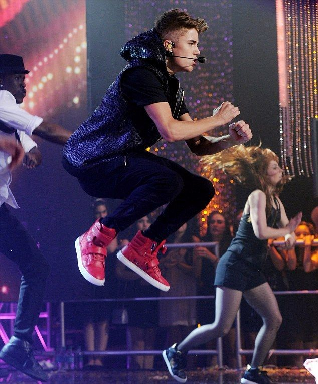 Justin Bieber performing on Dick Clark's New Year's Rockin' Eve with Ryan Seacrest 2013