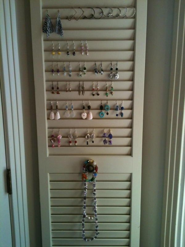 Louvered door. Use S hooks for necklaces or cute knobs on edges. Would be great at end of cabinetry or behind door