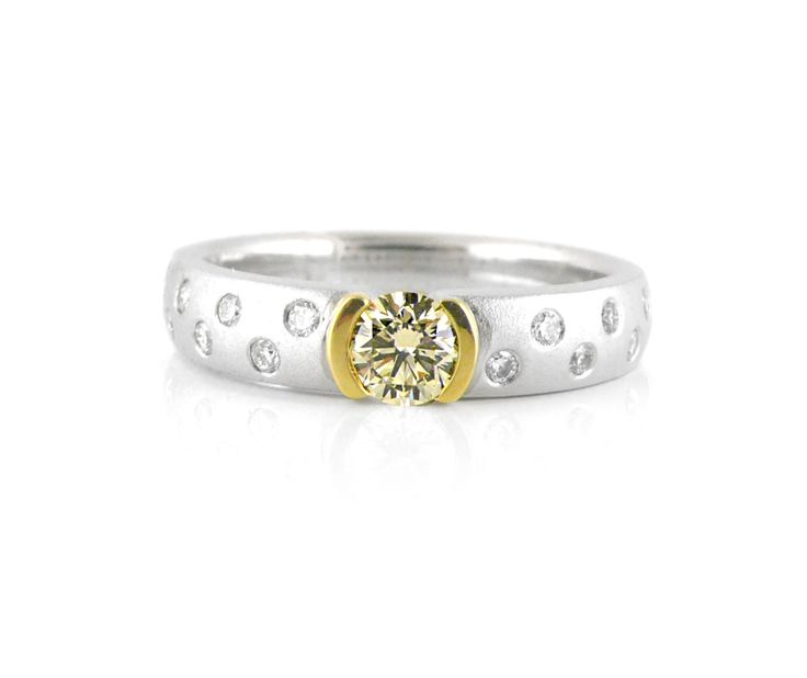 An 18ct White and Yellow Gold and Diamond Ring with a Fancy Yellow Diamond in the Center