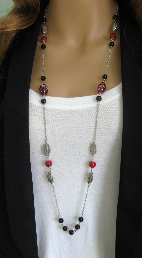 Long black beaded necklace with red and black glass beads, and silver metal beads, on silver metal chain. The necklace is 40 inches long.  ***SEE ALL THE NECKLACES IN MY SHOP AT: https://www.etsy.com/shop/RalstonOriginals?section_id=10816830&ref=shopsection_leftnav_1  This black beaded necklace is ready to send today, and comes in a gift box. See my other Jewelry on Etsy at http://www.etsy.com/shop/ralstonoriginals?view_type=gallery. I have a variety of styles including Necklaces…