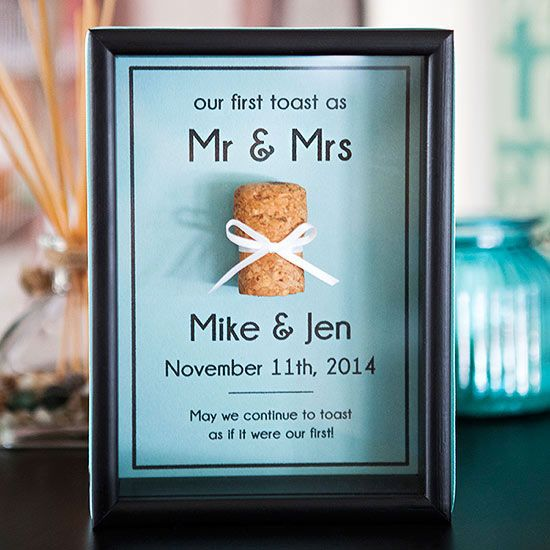 Cork Keepsake Frame - Create a meaningful keepsake of your first sip as husband and wife with a darling framed shadow box. Simply save the champagne or wine cork from your first toast, and embellish the display with a free printable backdrop and a bit of ribbon.