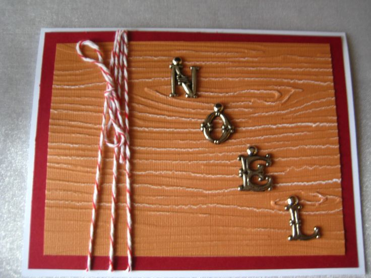 Stampin Up wood grain embossing and NOEL brads