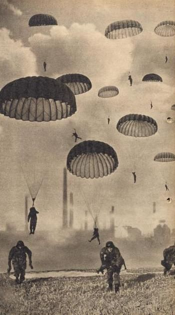 2 World War, German paratrooper, soldiers dropping from the sky landing on the ground. Vintage, photo, history, never forget.