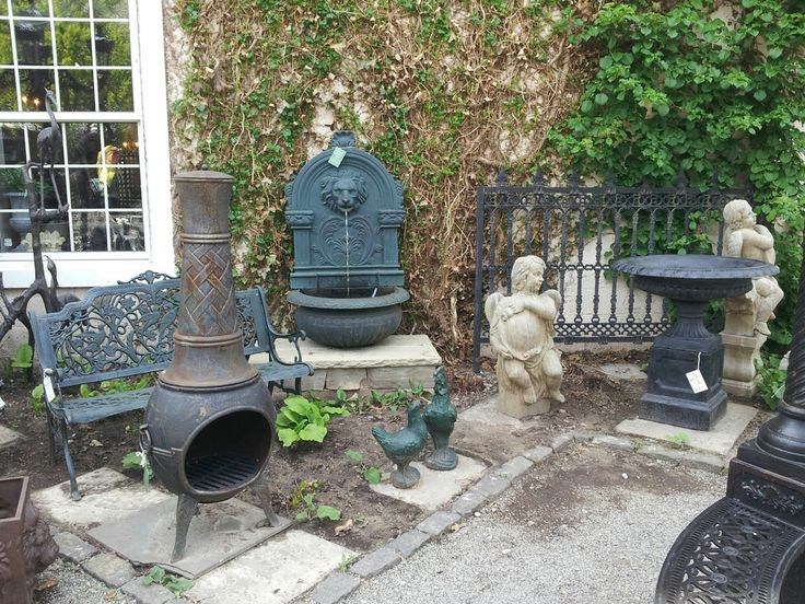 Cast iron wall fountain and iron fire chimney