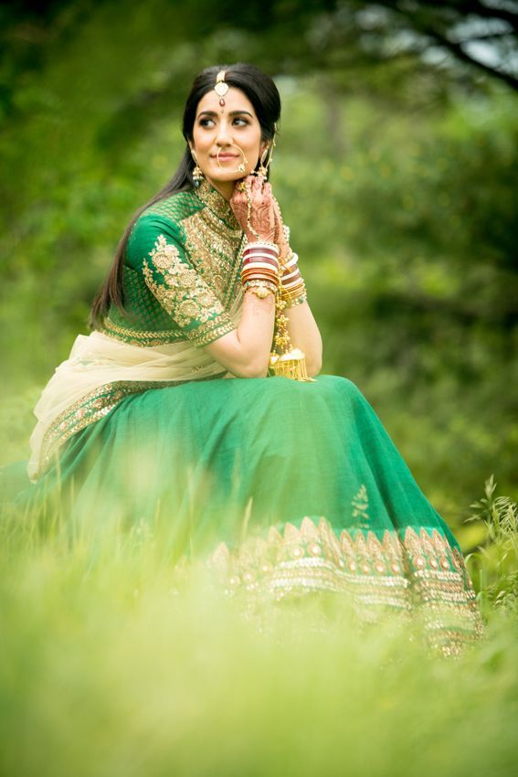 Puja the bride who rocked the emerald green Sabyasachi lehenga at her wedding in Toronto, photographed by Kumari Photo Cinema of Canada