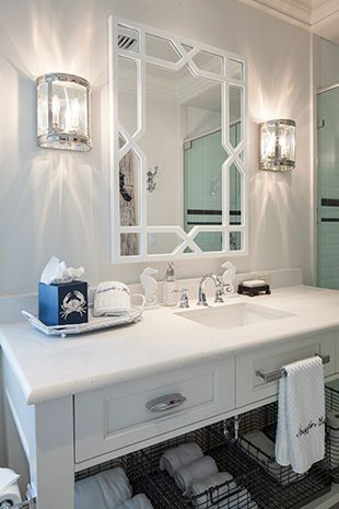 Joy Tribout Interior Design - towel hanger is close and below sink rather than far and above the sink