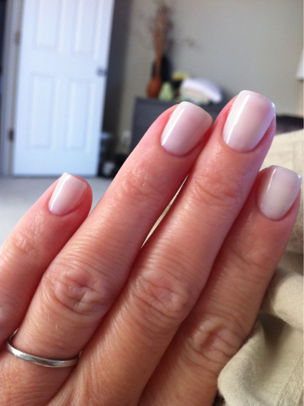 OPI Funny Bunny gel -- 3 coats and 1 izzy wizzy.  lasts forever, looks perfect.