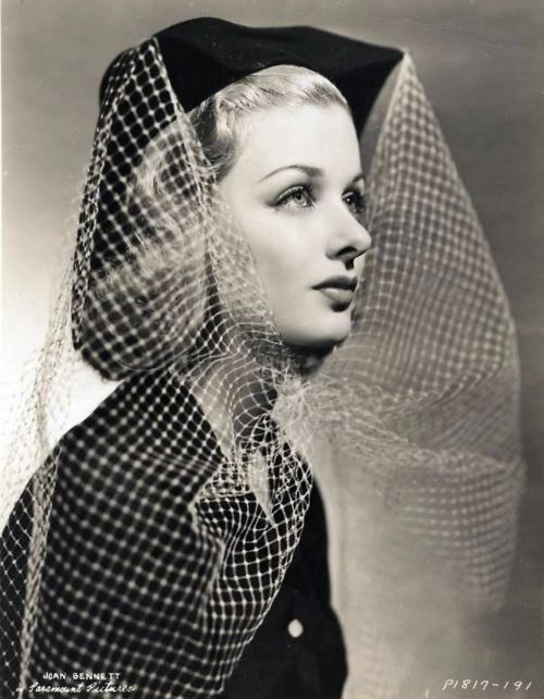Joan Bennett, 1930s, in a veiled hat.