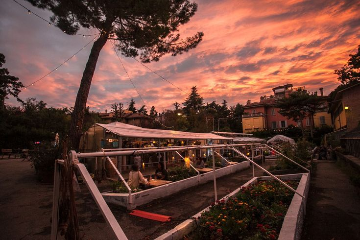 Bologna - the coolest greenhouse bar  - Le Serre dei Giardini Margherita al tramonto