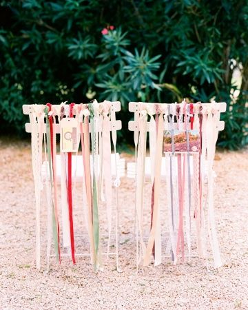 Pastel Ribbons    This bride and groom decked out the backs of their chairs with long strands of VV Rouleaux ribbons in a soft pastel palette.