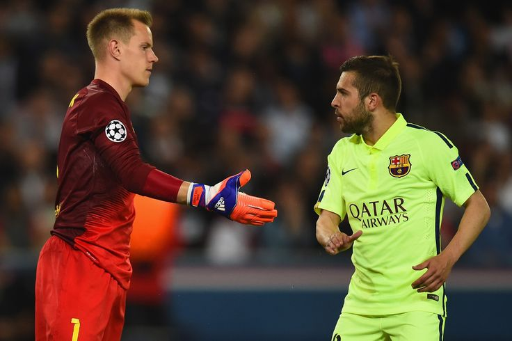 Jordi Alba of Barcelona congratulates Marc-Andre ter Stegen of Barcelona after a save during the UEFA Champions League Quarter Final First Leg match between Paris Saint-Germain and FC Barcelona at Parc des Princes on April 15, 2015 in Paris, France.