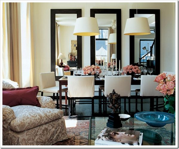 AD.  Dining room.   Two chandeliers.  Three mirrors.  Peach roses.  Beautiful.  Classic.