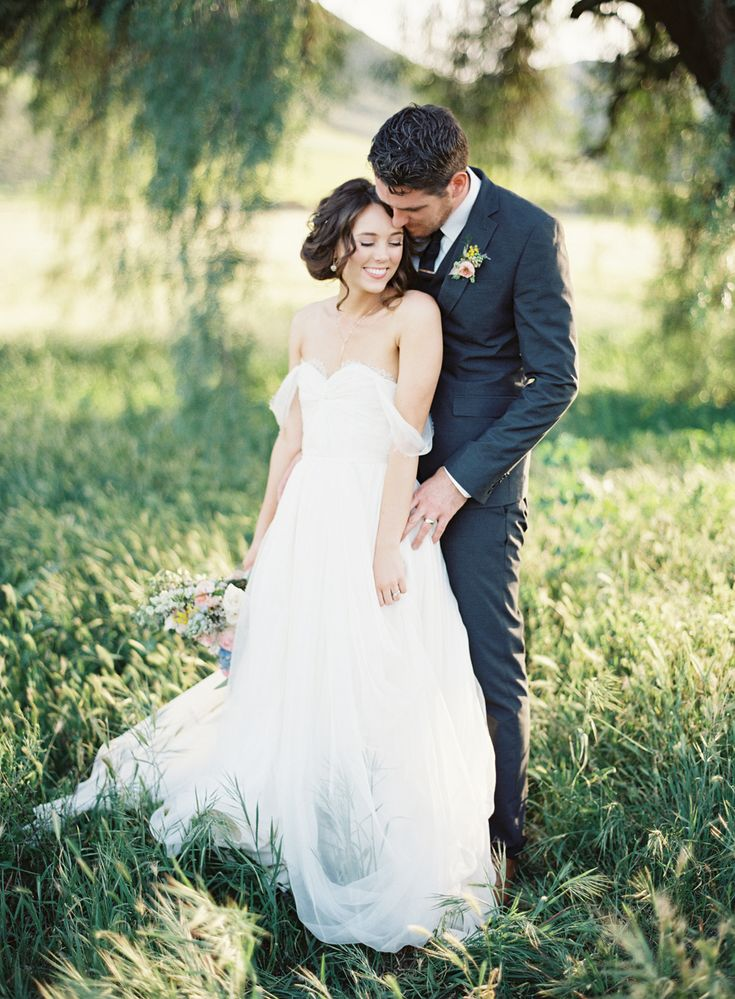This is so lovely. Pose inspiration for a bride and groom.