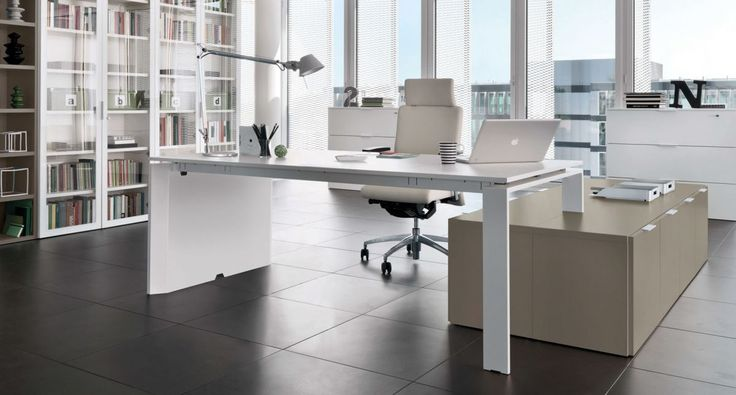Z575 - Executive table with Crono chair. Link System bookcase with glass doors and open column. Monopoli filing cabinets.