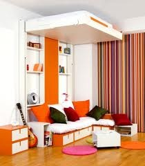 AWESOME.  The bed moves up!!  And love the orange.  The pin goes to google image.  Here is the link http://www.alspics.com/small-bedroom-designs-ideas-with-mobile-bed/