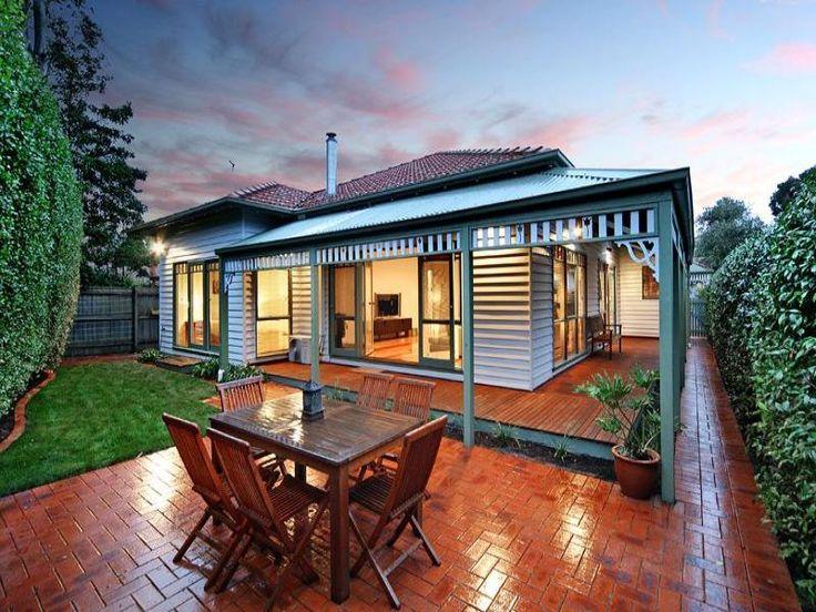 Corrugated iron victorian house exterior with porch & landscaped garden - House Facade photo 105150