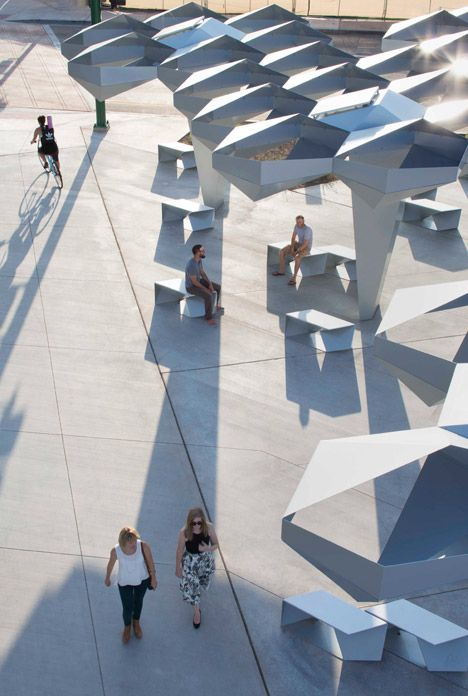 Steel modules were stitched together to form this faceted canopy that shades an urban park in the desert city of Phoenix, Arizona.