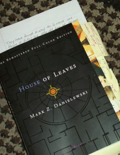 House of Leaves by Mark Z. Danielewski. Liked for similara reasons to Lovecraft in time and space being beyond human comprehension, hidden codes, clippings, notes and the like to supplement the store, strange typography & formatting.