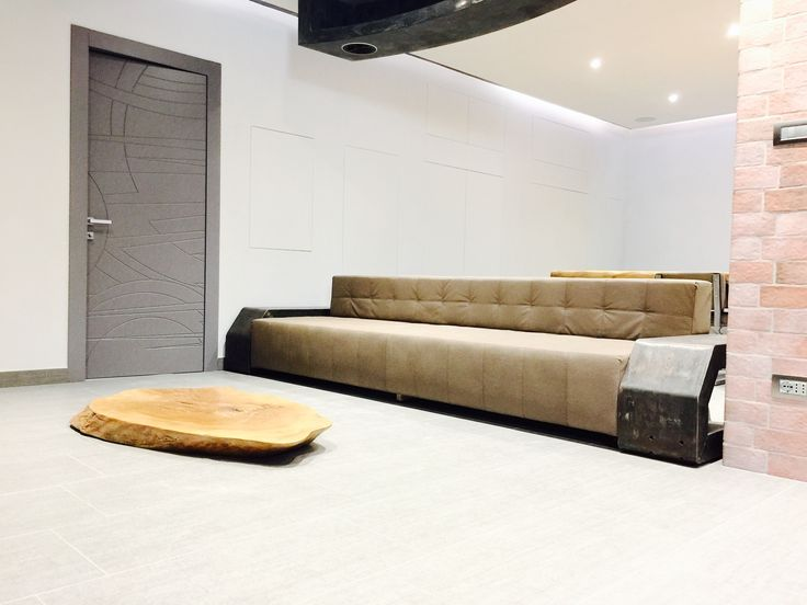 Sofà and coffee table made ​​of steel and wood. Integrated two subwoofers for HomeTeathre system. Home Modern Industrial Style.   Patrizio DE LEIDI