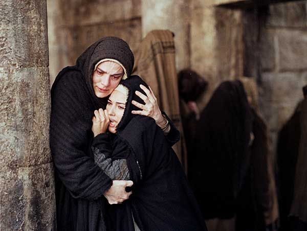 This particular scene shows the Jesus' Mother comforting  Mary Magdalene.... from The Passion of the Christ produced by Mel Gibson.  Bing Images