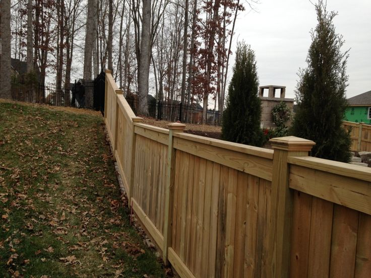 NATURAL WOOD FENCE - BRYANT FENCE COMPANY