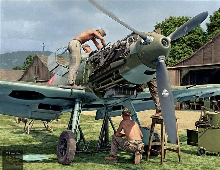 C: Aircraft mechanics of the Swiss Air Force working on a Messerschmitt Bf 109E-3 at Thun Airfield, Switzerland, 1940. Switzerland took delivery of its initial batch of BF109s in 1938, with the introduction of ten Bf 109Ds. Shortly afterwards, the country purchased an additional 80 Bf109E-3s which commenced arriving from April 1939 until just prior to Germany's invasion of France in 1940