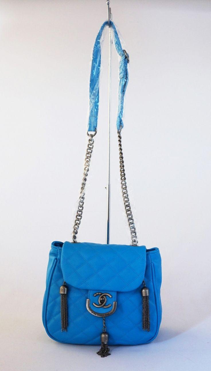 Tas emboss kincir cantik, tali rantai panjang. Cute elegan. Warna biru.  Uk 25x22