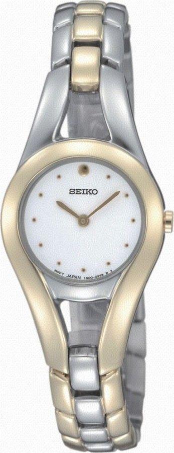 Seiko Dameshorloge staal bicolor SUJF60P1, elegant vormgegeven horloge met goudkleurige stalen kast, de rand van de kast loopt mooi door in de stalen horlogeband met vouwsluiting. De witte wijzerplaat heeft goudkleurige accenten en geeft een analoge tijdaanduiding. Elegant en trendy horloge voor de modebewuste vrouw. https://www.timefortrends.nl/horloges/seiko.html