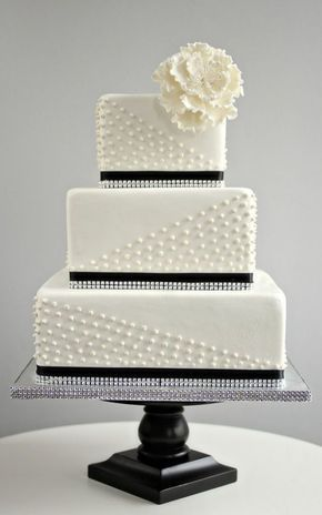 simple square black and white wedding cake with pearl detail
