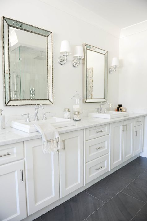 Airy All White Bathroom With Marble Counters And White Cabinets