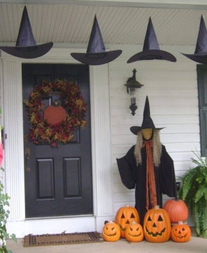 spooky styles decorating porch and entryway halloween ideas unusual hanging hats for front porch halloween decor completed with the black witch with - Halloween Outdoor Ideas
