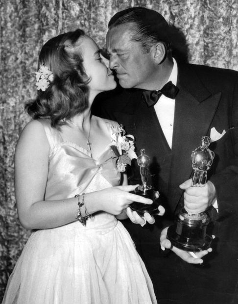 """Peggy Ann Garner and James Dunn with the Oscars they won for  """"A Tree Grows in Brooklyn"""", and deservedly so. March, 1946"""