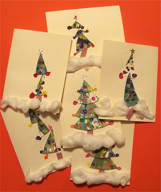 ...creating these cards using our spin art scraps from our Spin Art Christmas Trees from last week!   From Chocolate Muffin Tree.  These adorable trees are more craft than art, but even though all kids might make trees, at least each tree is completely individual. I love this activity for some deeply delightful reason I can't explain.