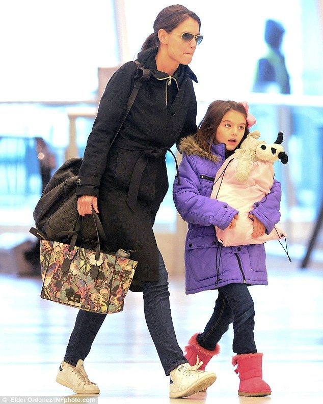 Big girl toys: Suri, aged 8, carried a sack full of toys, including a stuffed dog that was...